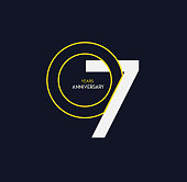 7 years anniversary elegance gold logo. linked number on dark background