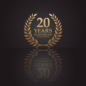 Vector of 20 years golden anniversary icon with dark color background. EPS Ai 10 file format.
