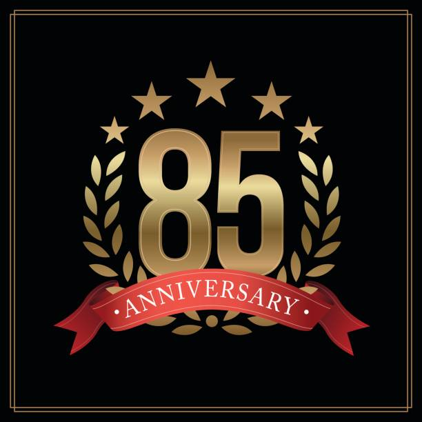 85 years golden anniversary icon, with star, red ribbon, and  laurel wreath isolated on black background, vector design - oscars stock illustrations, clip art, cartoons, & icons