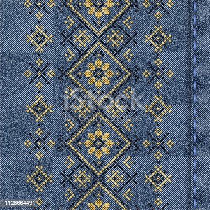 Vector denim background with traditional embroidery. Vector cross stitch embroidery. Seamless background pattern. Texture of denim fabric with embroidery.