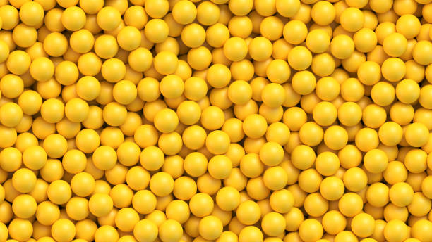 Yellow balls vector background Yellow balls background. Pile of yellow toy balls, sugar coated candy, pills or vitamins. Realistic vector background bead stock illustrations