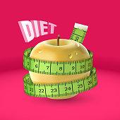 Yellow fresh apple, green measuring tape. Diet