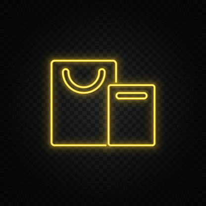 Yellow neon icon bags, shopping.Transparent background. Yellow neon vector icon