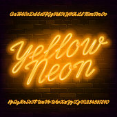 Yellow Neon script alphabet font. Neon color lowercase and uppercase bright letters and numbers. Stock vector typescript for your typography design.