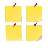 Yellow sticky note with pin clip isolated on white background.