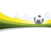 Vector illustration of a soccer ball on yellow and green background.