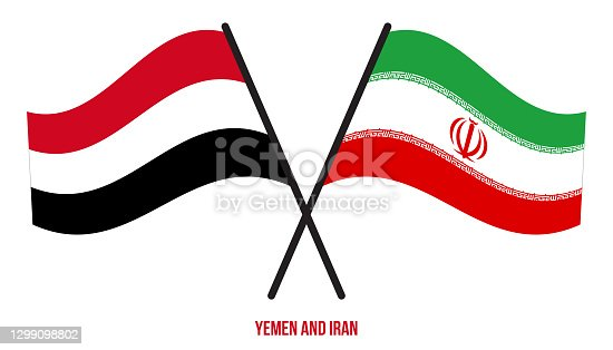 istock Yemen and Iran Flags Crossed And Waving Flat Style. Official Proportion. Correct Colors. 1299098802