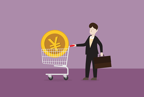 Yen coin in a shopping cart with businessman