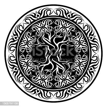 istock yggdrasil, viking tree of life, in ornamental tribal round frame 1305791135