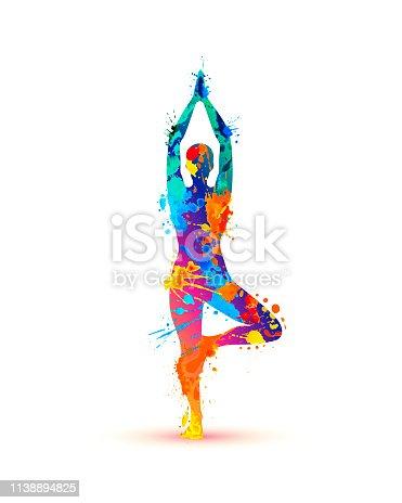 istock Yoga asana vrikshasana. Tree pose. Splash paint 1138894825