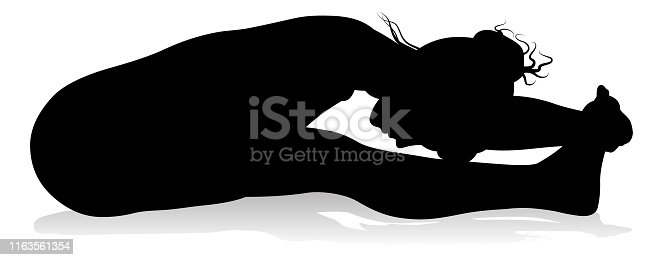 A silhouette of a woman in a yoga or pilates pose