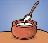 Fresh yogurt with wood spoon