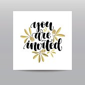 You are invited. Hand written calligraphy phrase with gold glitter olives and leaves for wedding invitation card. Modern lettering hand drawn image on white background. Greeting card.
