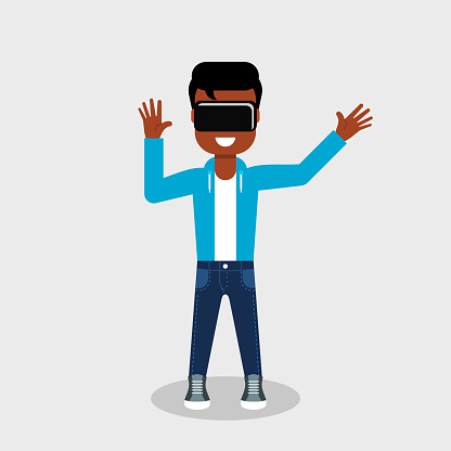 Young African American in jeans and sweatshirt is looking through virtual reality glasses looking excited.