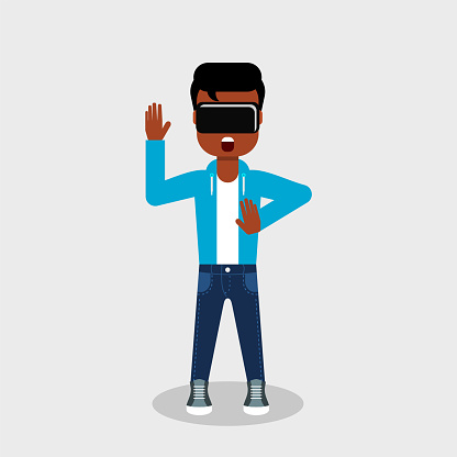 Young African American in jeans and sweatshirt is looking through virtual reality glasses looking scared.