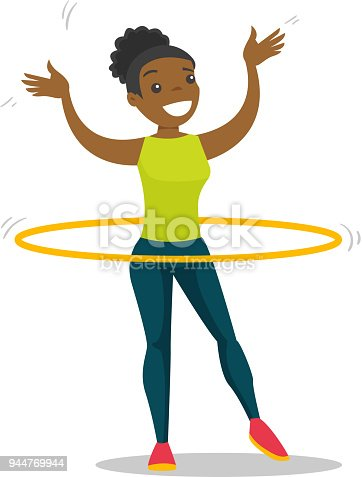 Young african woman doing exercises with hula hoop