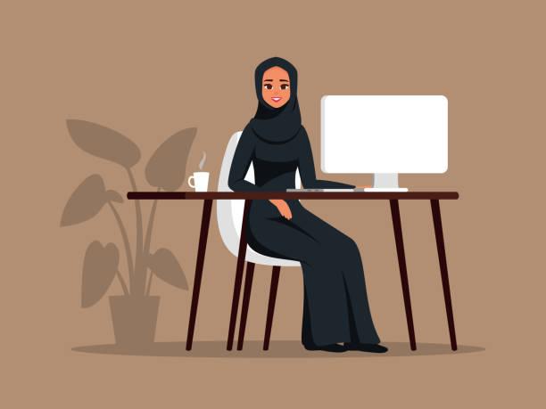 年輕的阿拉伯女孩坐在桌旁用電腦。 - emirati woman 幅插畫檔、美工圖案、卡通及圖標