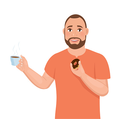 A young bearded guy holds a cup of coffee in one hand and a donut in the other.
