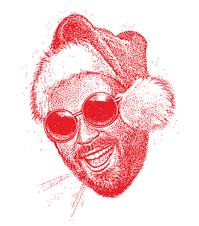 Young bearded hipster wearing Santa hat talking
