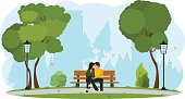 Young beautiful couple sitting in the park. vector