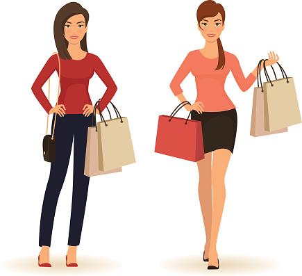 Young beautiful fashion women with shopping bags
