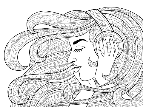 Young beautiful girl with long wavy hair listening to music in headphones. Tattoo or adult antistress coloring page. Black and white hand drawn doodle for coloring book