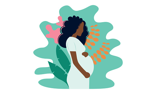 Young beautiful pregnant black woman in nature. Concept for pregnancy, motherhood.