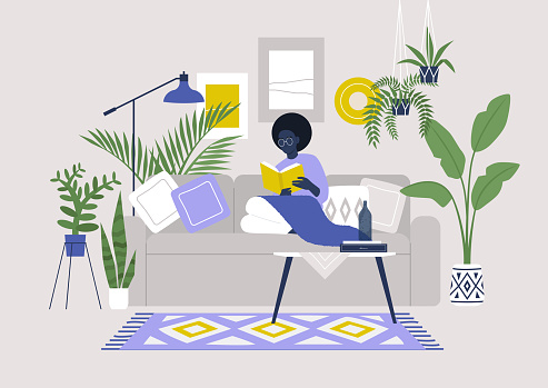Young black female character sitting on sofa and reading a book, cozy boho interior with plants and ethnic decoration, stay at home