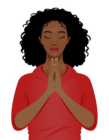 Young black woman praying