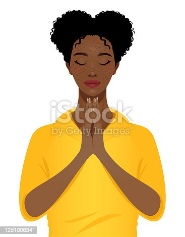 istock Young black woman praying with eyes closed 1251006341