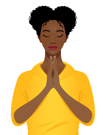 Young black woman praying with eyes closed portrait isolated on a white background.