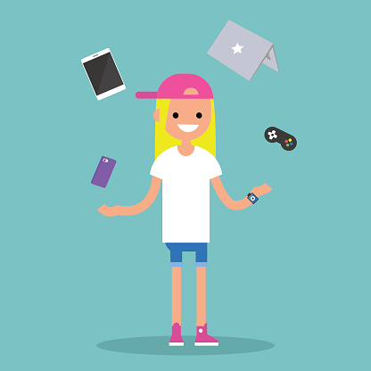 Young blond girl juggling electronic devices