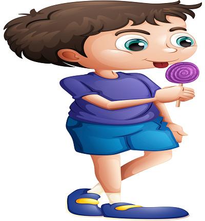 Young boy eating lollipop