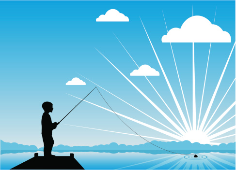Young boy fishing at sunrise