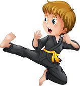 Young boy showing his karate moves