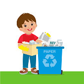 Young Boy Throwing Paper In Recycle Bin. Waste Recycling.