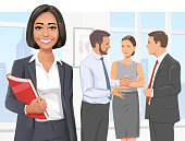 Vector illustration of a smiling young businesswoman in her office. In the background three of her coworkers are having a discussion. Concept for success, business meetings, confidence, individuality, standing out from the crowd and teamwork.