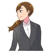 Young business woman stares into the distance with a smile. She is confident.