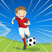Young cartoon boy dribbles soccer ball downfield