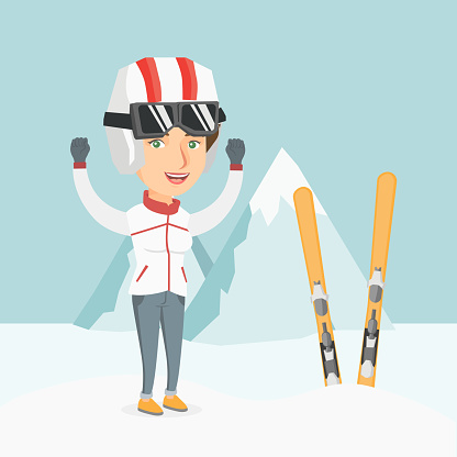 Young caucasian skier standing with raised hands