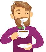Young caucasian white man enjoying cup of coffee