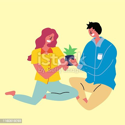 istock Young couple caring for a plant together 1160619293