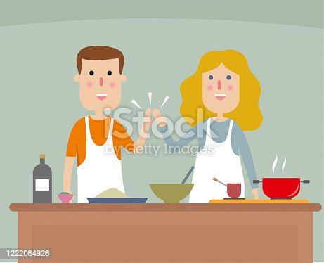 istock Young couple cooking dinner 1222084926