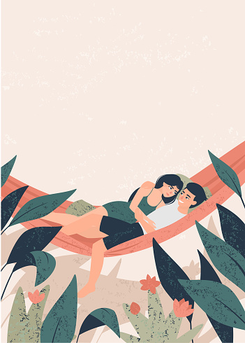 Young couple lie in a hammock in the tropics