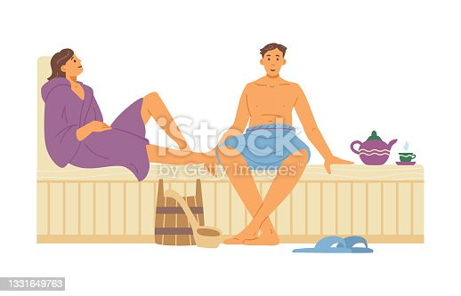 istock Young couple man and woman relaxing on wooden bench in hot steam sauna 1331649763