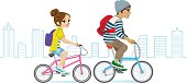 Young couple riding Bicycle in the Cityscape.
