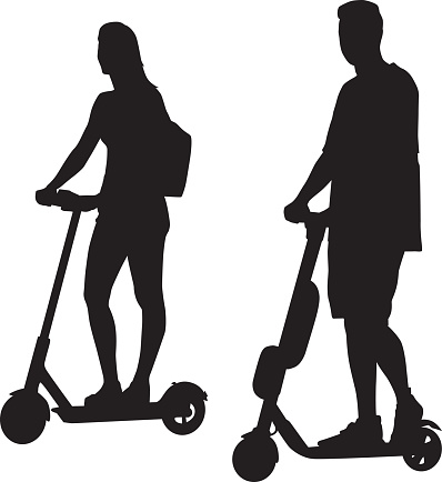 Young Couple Riding Scooters Silhouettes