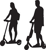 Vector silhouette of a young couple riding scooters.