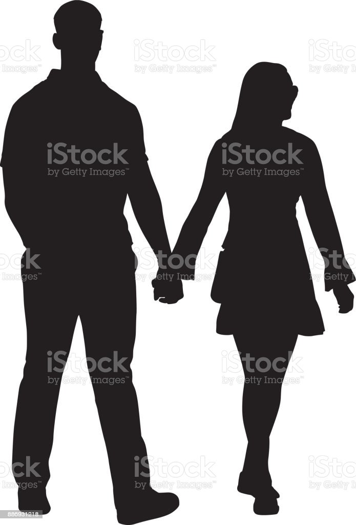 Young Couple Walking Hand In Hand