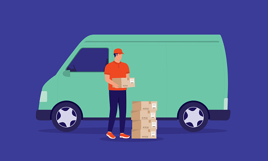 Young Delivery Man In Uniform Unloading Courier Boxes Out From The Van. Delivery And Logistic Services.